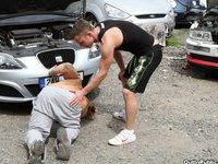 Two muscled guys barebacking hard on the car