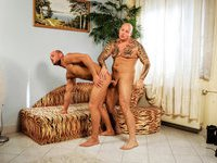 Muscular tattooed stud wanks off and drills his friend's butt hole